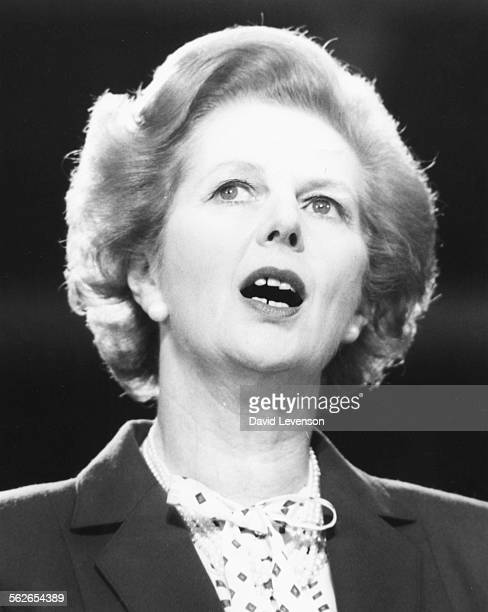 British Prime Minister Margaret Thatcher pictured singing during the Religious Service at the start of the Conservative Party Conference in Blackpool...