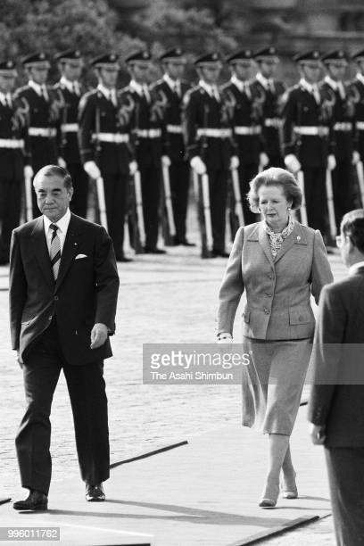 British Prime Minister Margaret Thatcher reviews the honour guard with Japanese Prime Minister Yasuhiro Nakasone during the welcome ceremony ahead of...