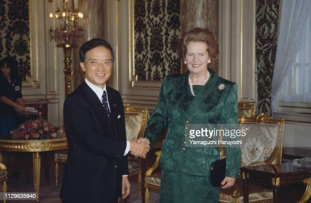 British Prime Minister Margaret Thatcher shakes hands with Japanese Prime Minister Toshiki Kaifu prior to their meeting at the Akasaka State...