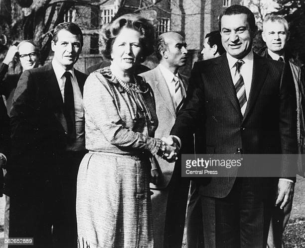 British Prime Minister Margaret Thatcher shaking hands with Egyptian President Hosni Mubarak outside her home at Chequers England February 3rd 1982