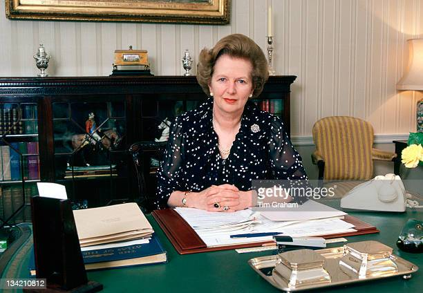 British Prime Minister Margaret Thatcher sits at her desk in her office at her official residence at 10 Downing Street 1987 in London England