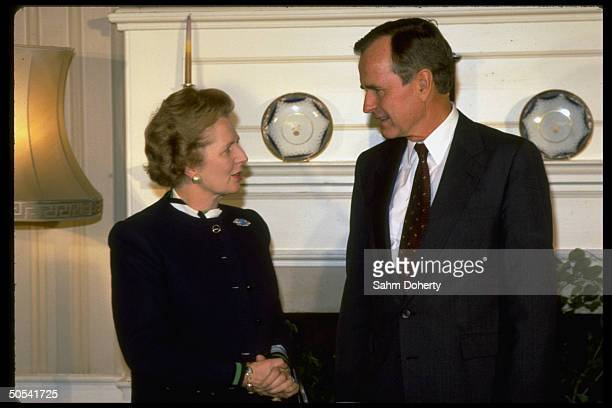 British Prime Minister Margaret Thatcher standing with US VicePresident George Bush