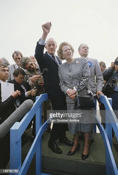 British Prime Minister Margaret Thatcher with Conservative Party aides and reporters during the UK general election campaign, 1987.