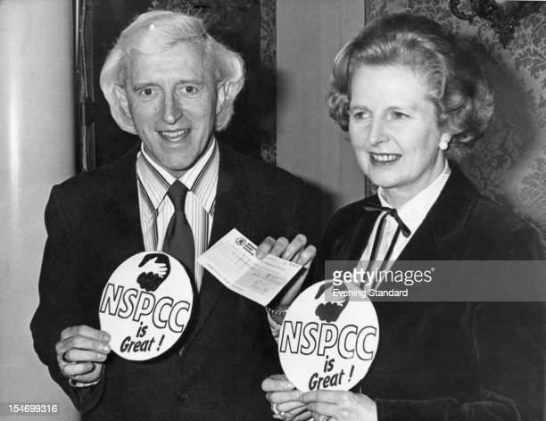 British Prime Minister Margaret Thatcher with English dj and television presenter Jimmy Savile at an NSPCC fundraising presentation 6th March 1980