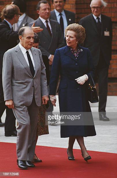 British Prime Minister Margaret Thatcher with French President Francois Mitterrand as they arrive for the opening ceremony at Kensington Palace...