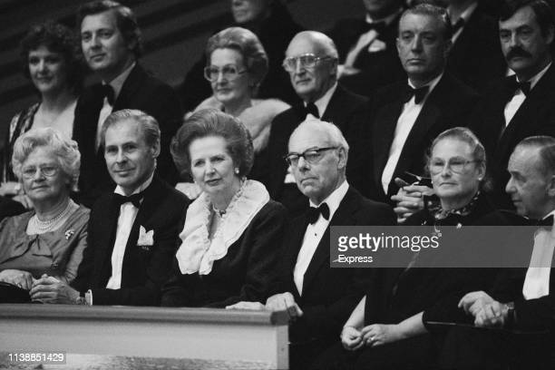 British Prime Minister Margaret Thatcher with her husband British businessman Denis Thatcher watching English ice dancers Jayne Torvill and...