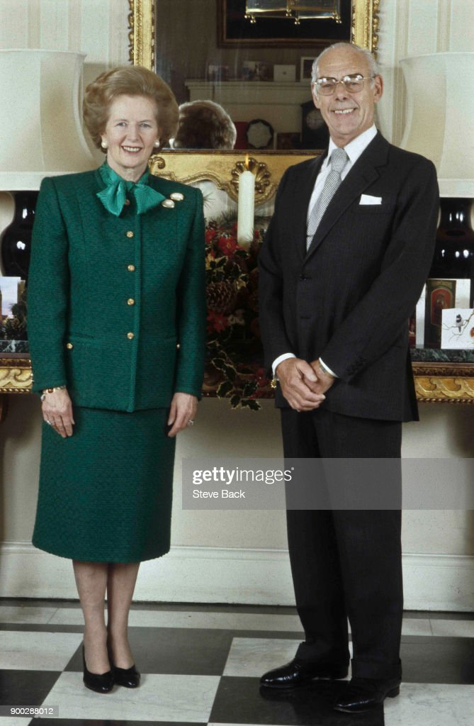 British Prime Minister Margaret Thatcher with her husband Denis Thatcher stands in the entrance hall of No10 Downing Street the official residence of the sitting British Prime Minister for her 1987 Christmas Card official photograph on October 14, 1987 in London, England.
