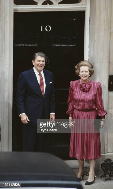 British Prime Minister Margaret Thatcher with US President Ronald Reagan on the steps of 10 Downing Street, the day after the official start of the...
