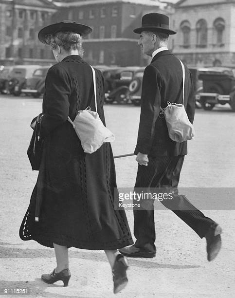 British Prime Minister Neville Chamberlain  and his wife Anne crossing Horse Guards Parade after their usual morning walk in St James's Park London...
