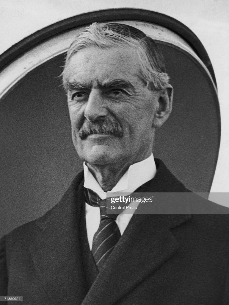 British Prime Minister Neville Chamberlain (1869 - 1940) disembarks from an aircraft, 1938.