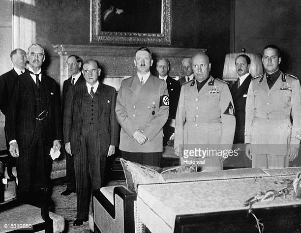 British Prime Minister Neville Chamberlain French Premier Edouard Daladier German Chancellor Adolf Hitler Italian Prime Minister Benito Mussolini and...