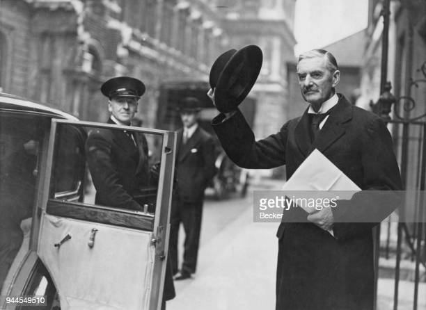 British Prime Minister Neville Chamberlain leaves 10 Downing Street in London for the Houses of Parliament to discuss the results of the Munich...