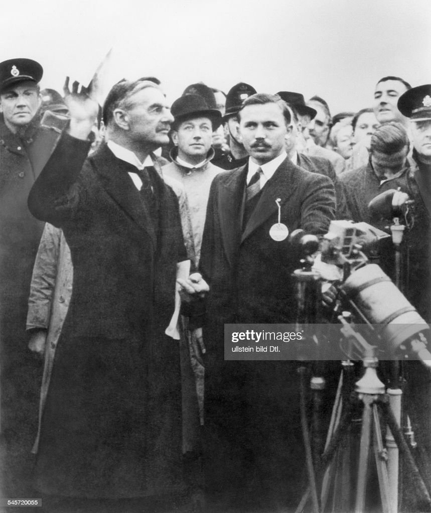 British Prime Minister Neville Chamberlain Presenting The Document