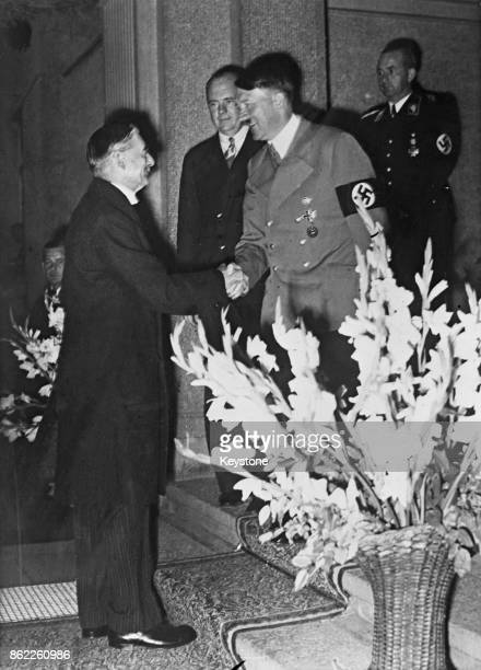 British Prime Minister Neville Chamberlain shakes hands with German Chancellor Adolf Hitler at Bad Godesberg Germany during the Sudeten Crisis 24th...