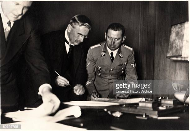British Prime Minister Neville Chamberlain Signing Munich Agreement, Munich, Germany, September 30, 1938 .