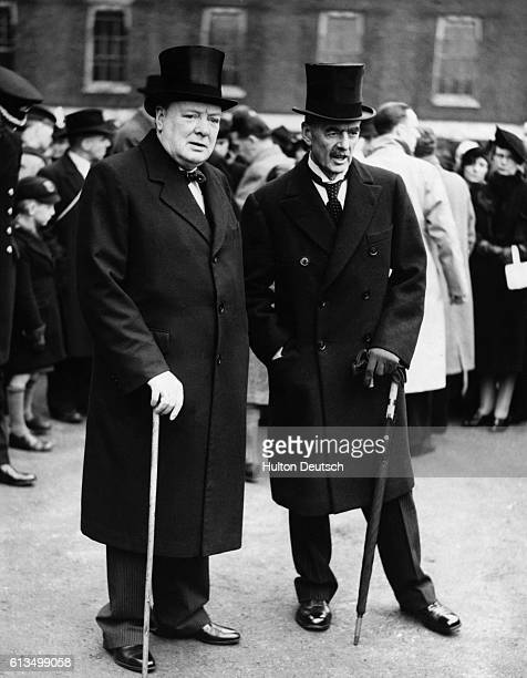 British Prime Minister Neville Chamberlain with his future successor Sir Winston Churchill at a medal ceremony attended by the King London ca 1939