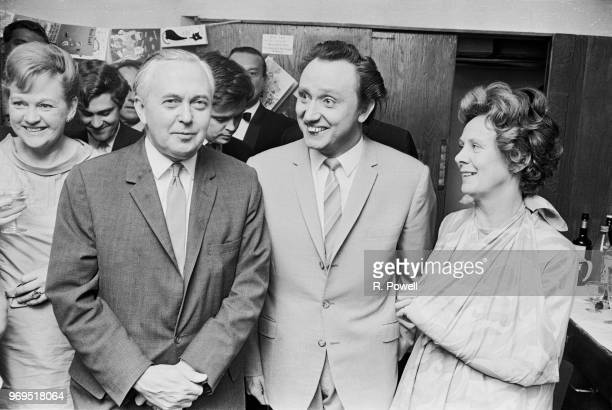 British Prime Minister of the United Kingdom Harold Wilson with his wife English poet Mary Wilson and English comedian Ken Dodd backstage after the...