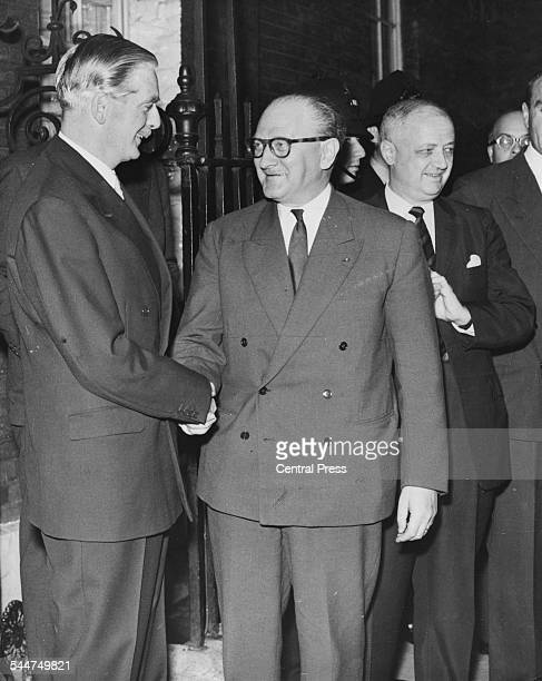 British Prime Minister Sir Anthony Eden shaking hands with his French counterpart Guy Mollet outside 10 Downing Street London September 10th 1956