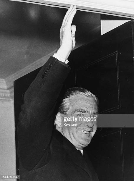 British Prime Minister Sir Anthony Eden waving as he returns to 10 Downing Street following a holiday to Jamaica London December 15th 1956