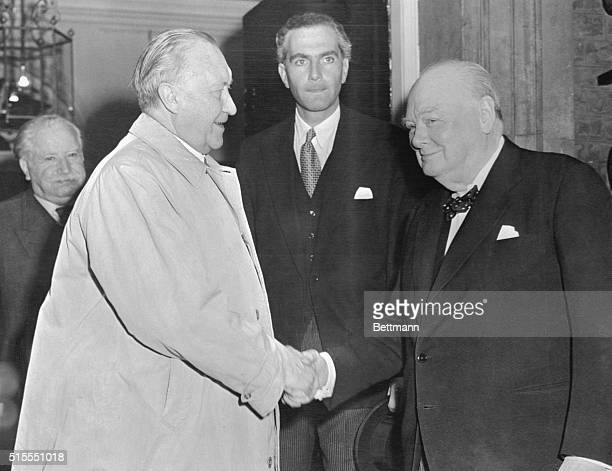 British Prime Minister Sir Winston Churchill shakes hands with German Chancellor Konrad Adenauer after a luncheon given by the Prime Minister at 10...