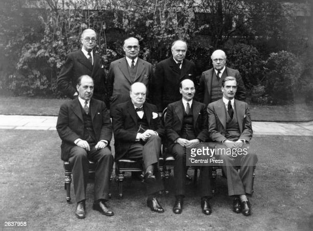 British Prime Minister Sir Winston Churchill , with the War Cabinet in 1941; from left to right seated, Sir John Anderson , Churchill, Clement Attlee...