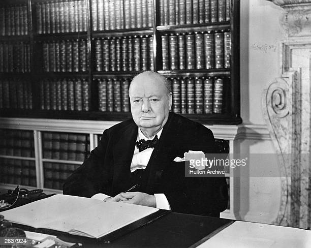 British prime minister Sir Winston Leonard Spencer Churchill sitting at his desk Original Publication People Disc HW0329