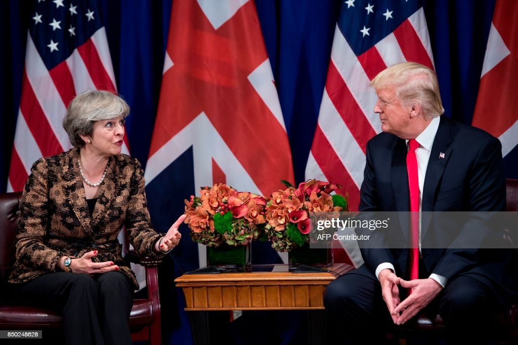 British Prime Minister Theresa May address the press as US President Donald Trump listens on during a meeting at the Palace Hotel in New York, on the sidelines of the 72nd United Nations General Assembly, on September 20, 2017. / AFP PHOTO / Brendan Smialowski