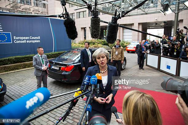 British Prime Minister Theresa May addresses assembled media as she arrives at the Council of the European Union on the first day of a two day summit...