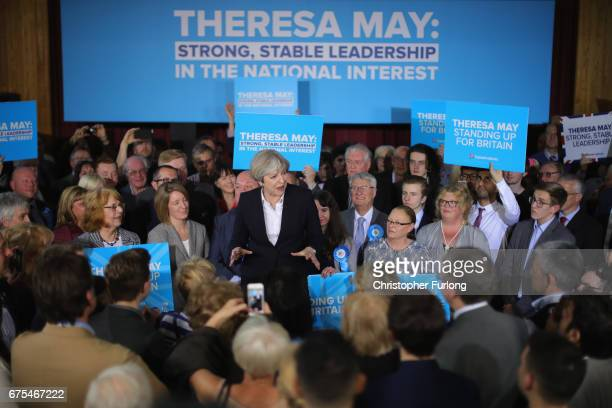 British Prime Minister Theresa May addresses supporters at an election campaign rally on May 1 2017 in Mawdesley Village Hall near Ormskirk England...