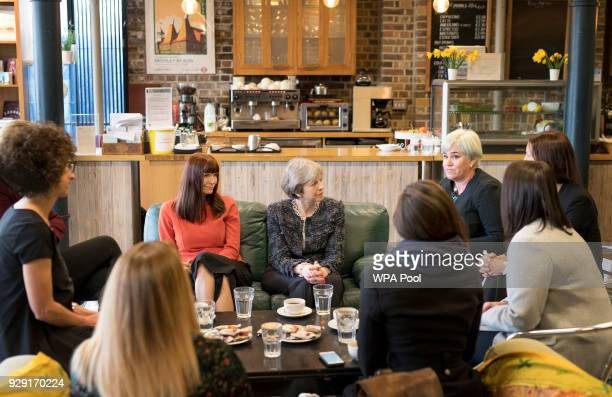 British Prime Minister Theresa May and British Home Secretary Amber Rudd meet with survivors of domestic abuse at House Mill BromleybyBow on March 8...