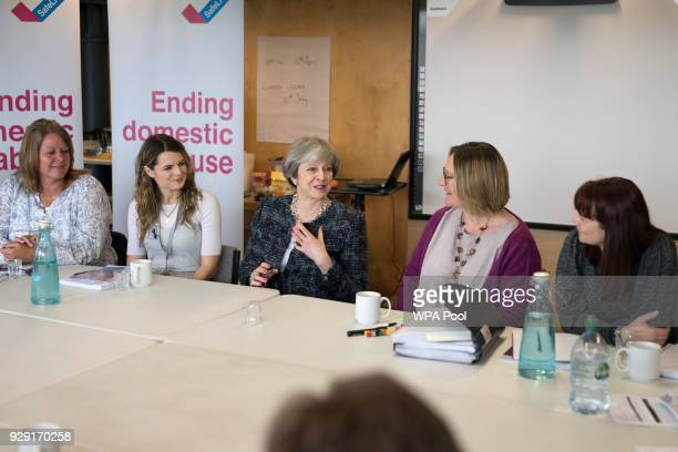 British Prime Minister Theresa May and British Home Secretary Amber Rudd drop in on a training session for Independent Domestic Violence Advisors at...