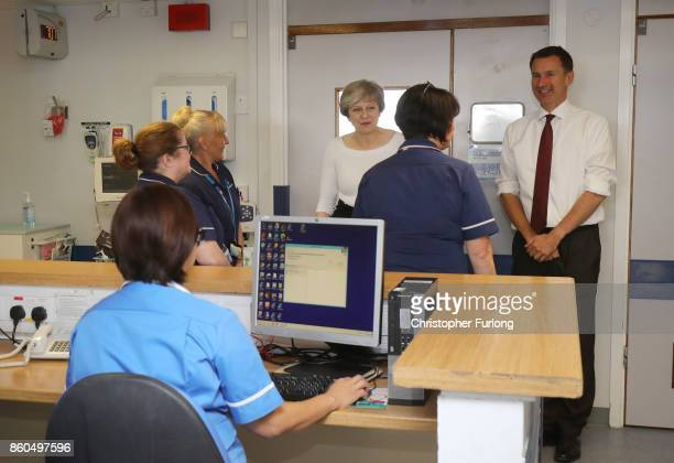 British Prime Minister Theresa May and British Secretary of State for Health Jeremy Hunt speak to nurses and members of staff as they visit to the...