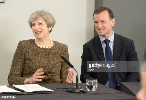 British Prime Minister Theresa May and British Wales Secretary Alun Cairns are pictured during a bilateral meeting at the Liberty Stadium in Swansea...