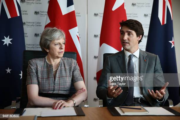 British Prime Minister Theresa May and Canadian Prime Minister Justin Trudeau attend a meeting at the National Cyber Security Centre on April 18 2018...