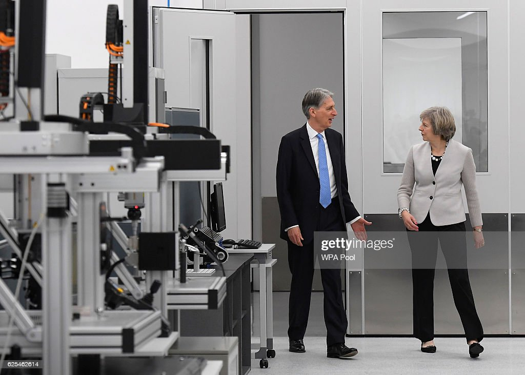 British Prime Minister, Theresa May and Chancellor of the Exchequer, Philip Hammond tour the Renishaw innovation and engineering plant on November 24, 2016 in Wootton, England.