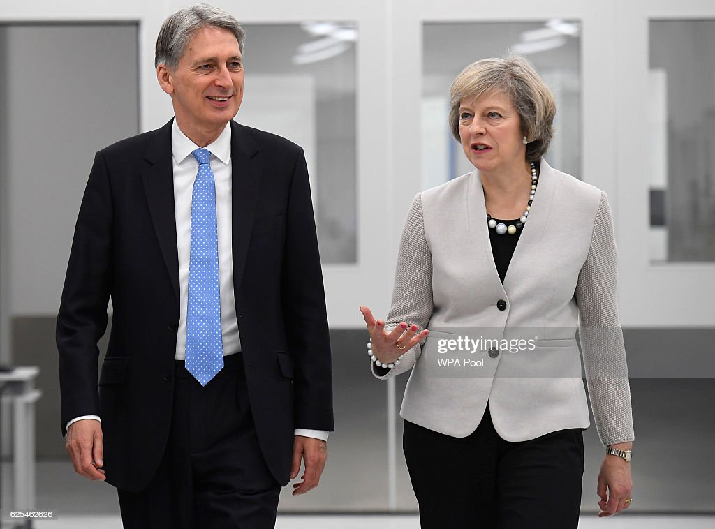 Theresa May And Philip Hammond Visit Renishaw Innovation and Engineering Plant