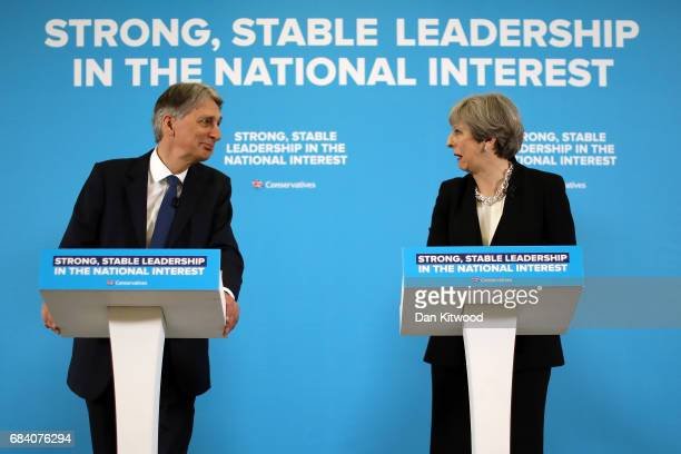 British Prime Minister Theresa May and Chancellor of the Exchequer Philip Hammond hold a Conservative Party Press Conference at One Canada Square on...
