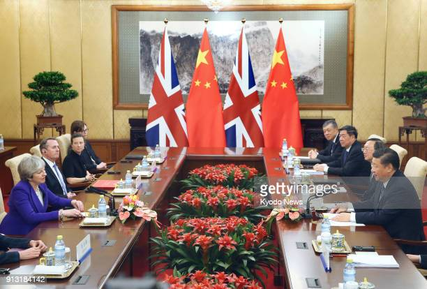 British Prime Minister Theresa May and Chinese President Xi Jinping hold talks at the Diaoyutai state guesthouse in Beijing on Feb 1 2018 ==Kyodo