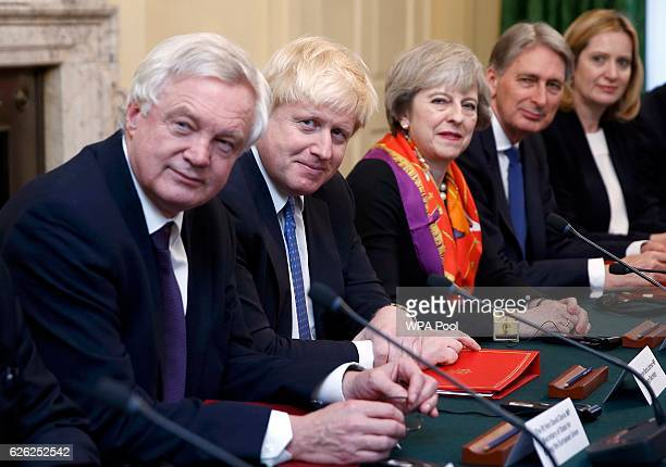 British Prime Minister Theresa May and David Davies Secretary of State for Exiting the European Union Foreign Secretary Boris Johnson May Chancellor...