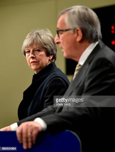 British Prime Minister Theresa May and European Commission chief JeanClaude Juncker give a press conference as they meet for Brexit negotiations on...