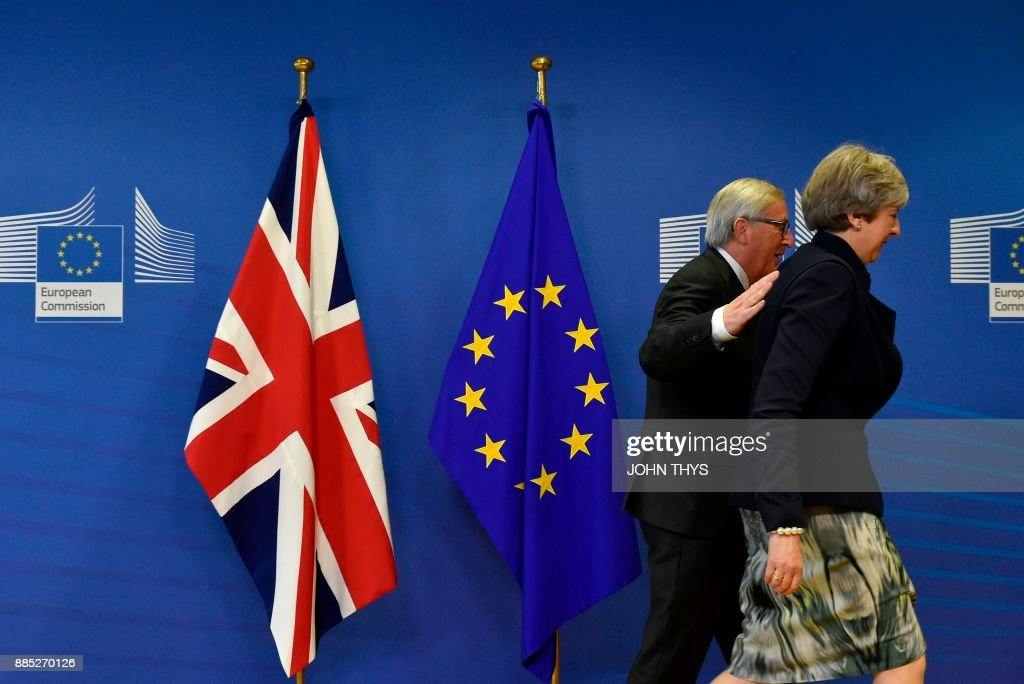 TOPSHOT - British Prime Minister Theresa May (R) and European Commission chief Jean-Claude Juncker arrive for a Brexit negotiation meeting on December 4, 2017 at the European Commission in Brussels. British Prime Minister Theresa May meets European Commission chief Jean-Claude Juncker on December 4 as an 'absolute' deadline to reach a Brexit divorce deal expires /
