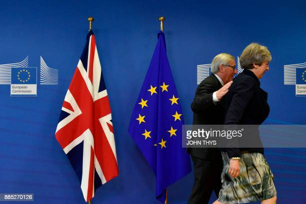 TOPSHOT British Prime Minister Theresa May and European Commission chief JeanClaude Juncker arrive for a Brexit negotiation meeting on December 4...