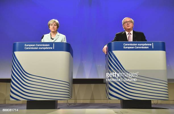 British Prime Minister Theresa May and European Commission President JeanClaude Juncker address a press conference at the European Commission in...