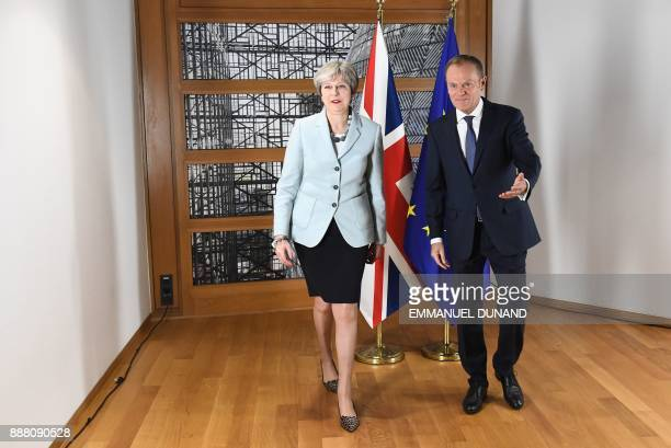 TOPSHOT British Prime Minister Theresa May and European Council President Donald Tusk leave after posing for photographers at the European Council in...
