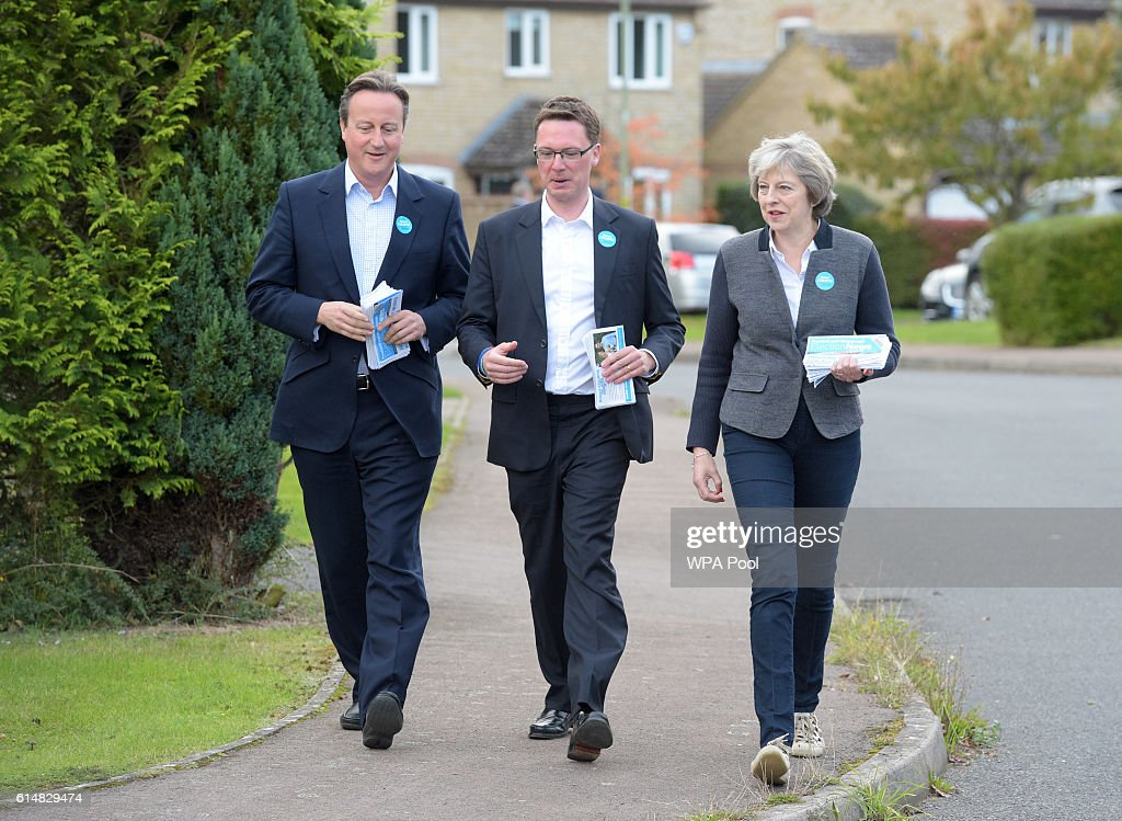 British Prime Minister Theresa May and former Prime Minister David Cameron (L) walk with Robert Courts, the Conservative candidate for the forthcoming Witney by-election, as they campaign on October 15, 2016 in Hanborough, England.