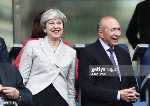 British Prime Minister Theresa May and French Interior Minister Gerard Collomb in discussion prior to the International Friendly match between France...