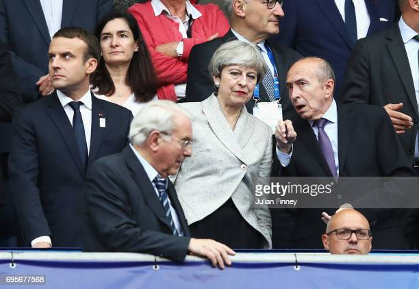 British Prime Minister Theresa May and French Interior Minister Gerard Collomb in discussion as French President Emmanuel Macron looks on prior to...