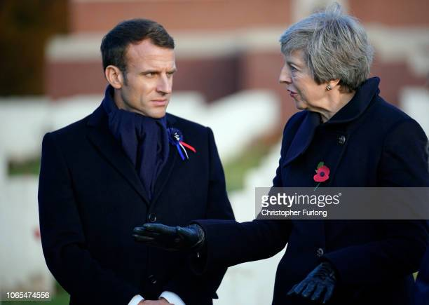 British Prime Minister Theresa May and French President Emmanuel Macron meet after a wreath-laying ceremony at Thiepval Memorial on November 09, 2018...