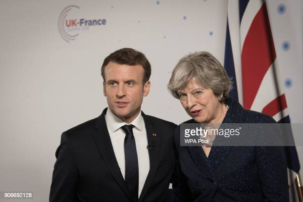 British Prime Minister Theresa May and French President Emmanuel Macron attend a press conference at the Royal Military Academy Sandhurst after...