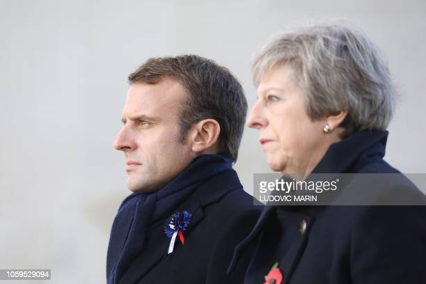 British Prime Minister Theresa May and French President Emmanuel Macron walk at the World War I French-British memorial of Thiepval, northern France,...